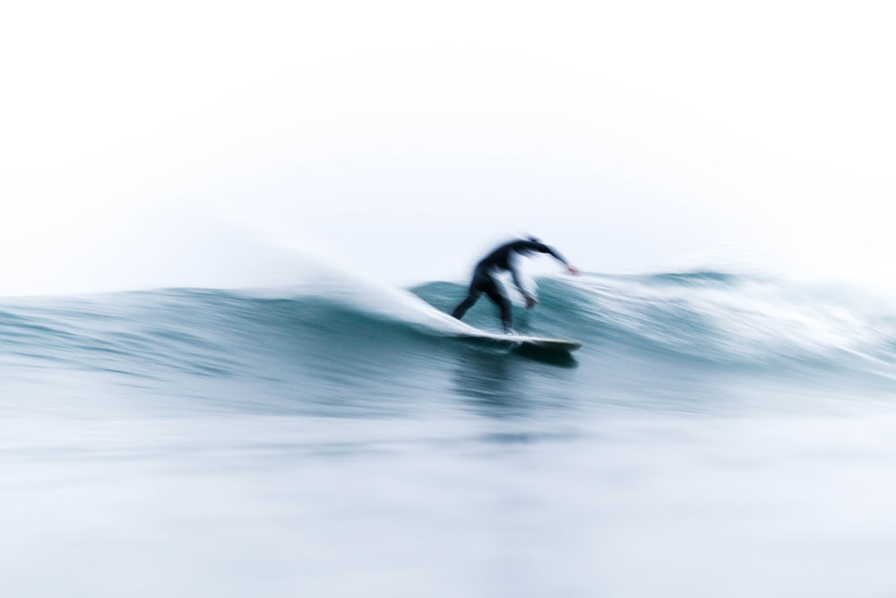 person on surfboard riding waves