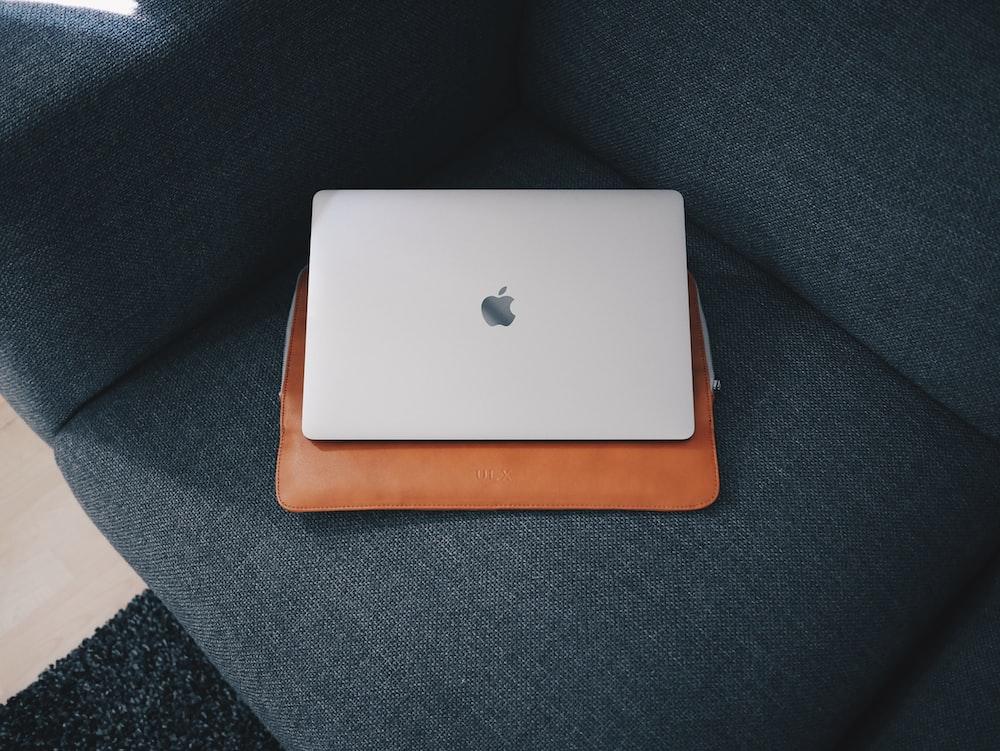 Apple MacBook on blue cushion