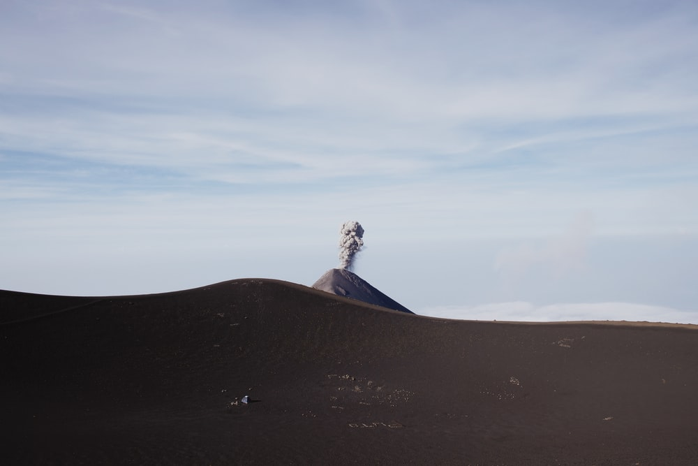 erupting volcano during daytime