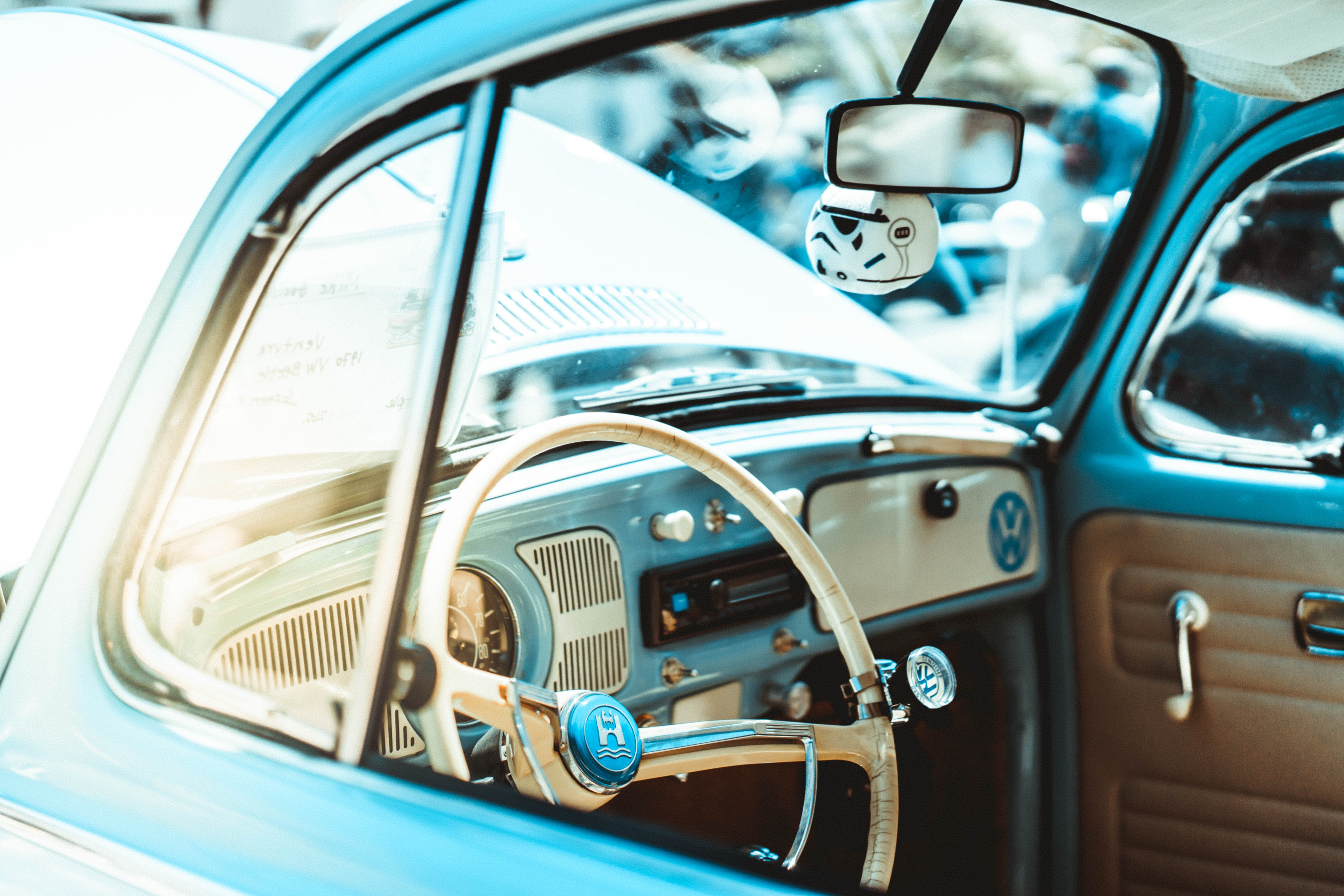shallow focus photography of white car steering wheel