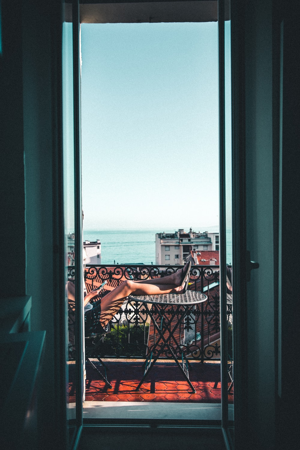 person sitting on balcony