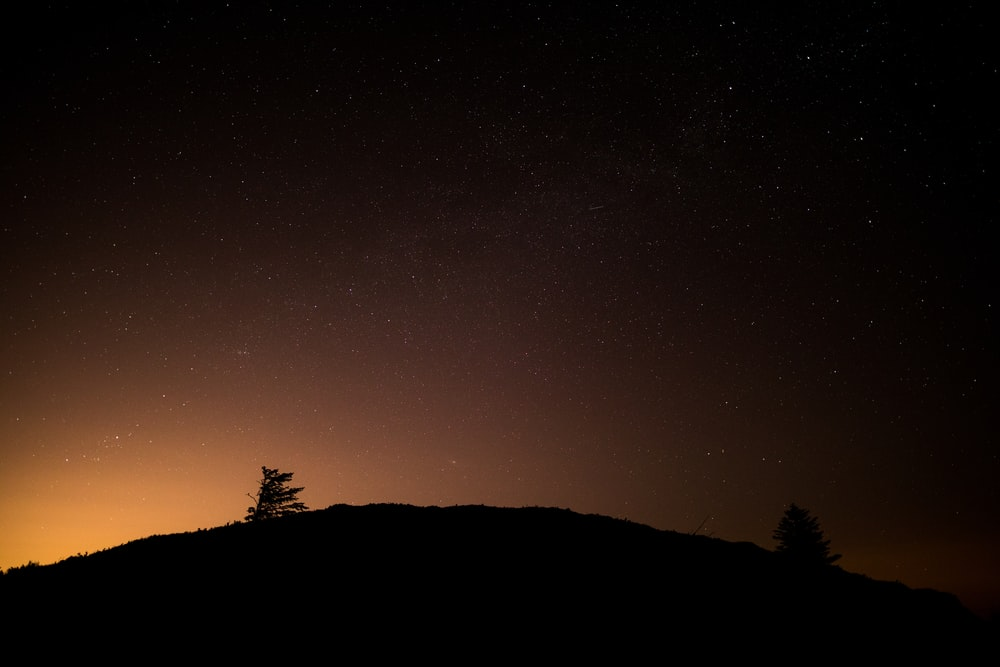 mountain silhouette during night time