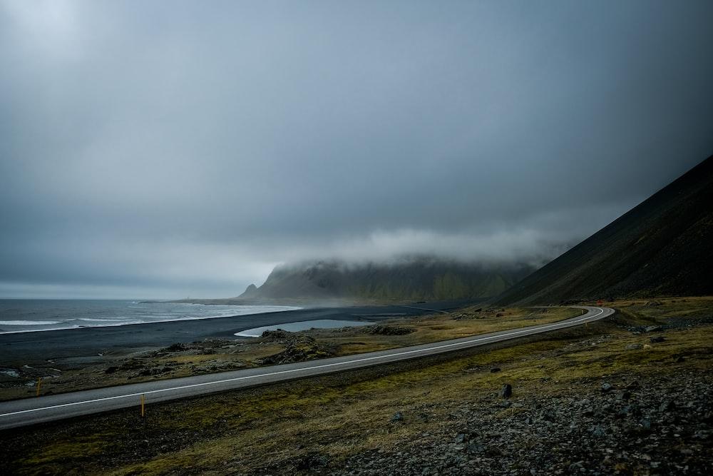 landscape photography of asphalt road near mountains