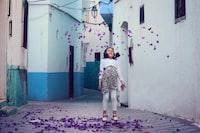falling petals under girl