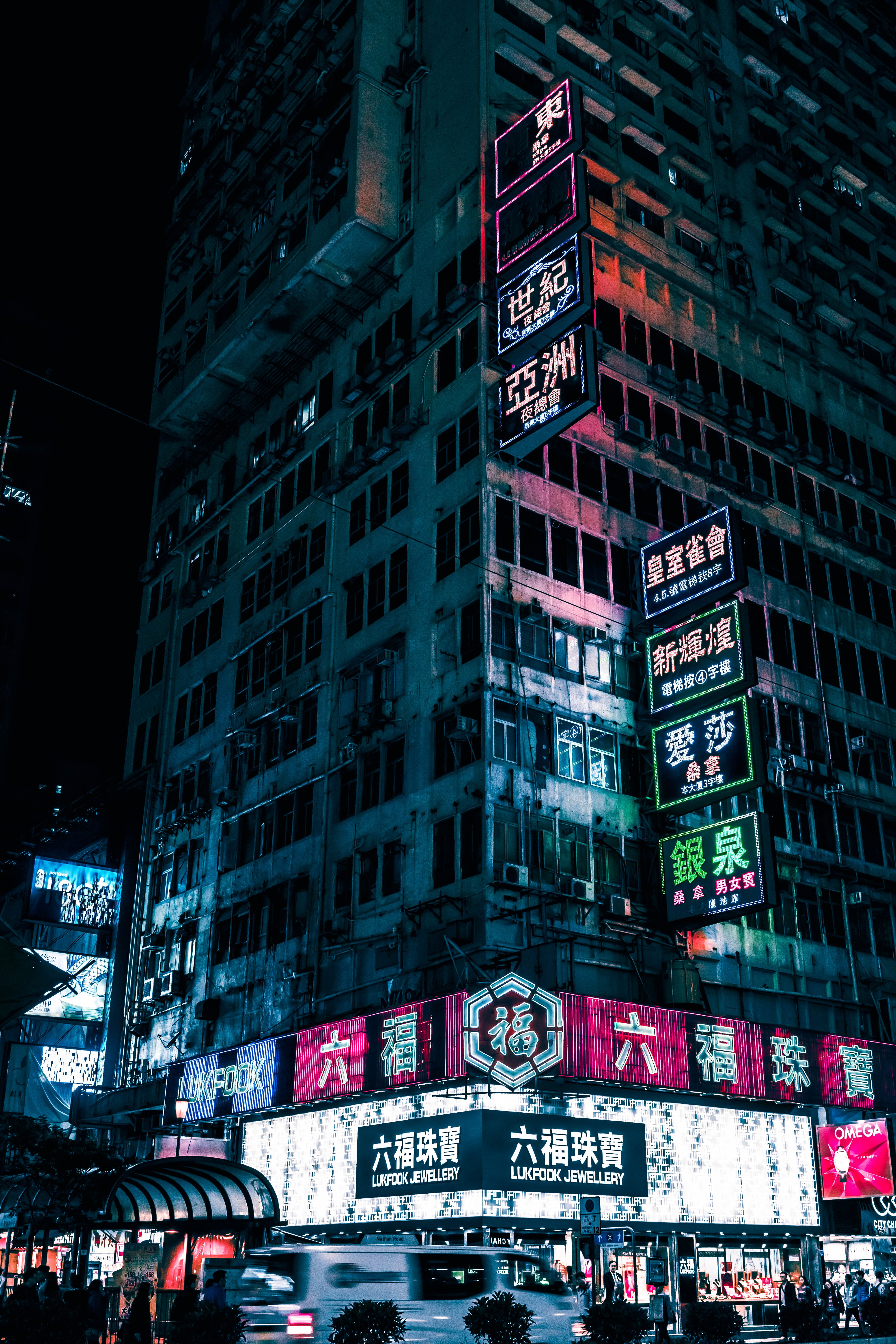high-rise building with lighted neon signage
