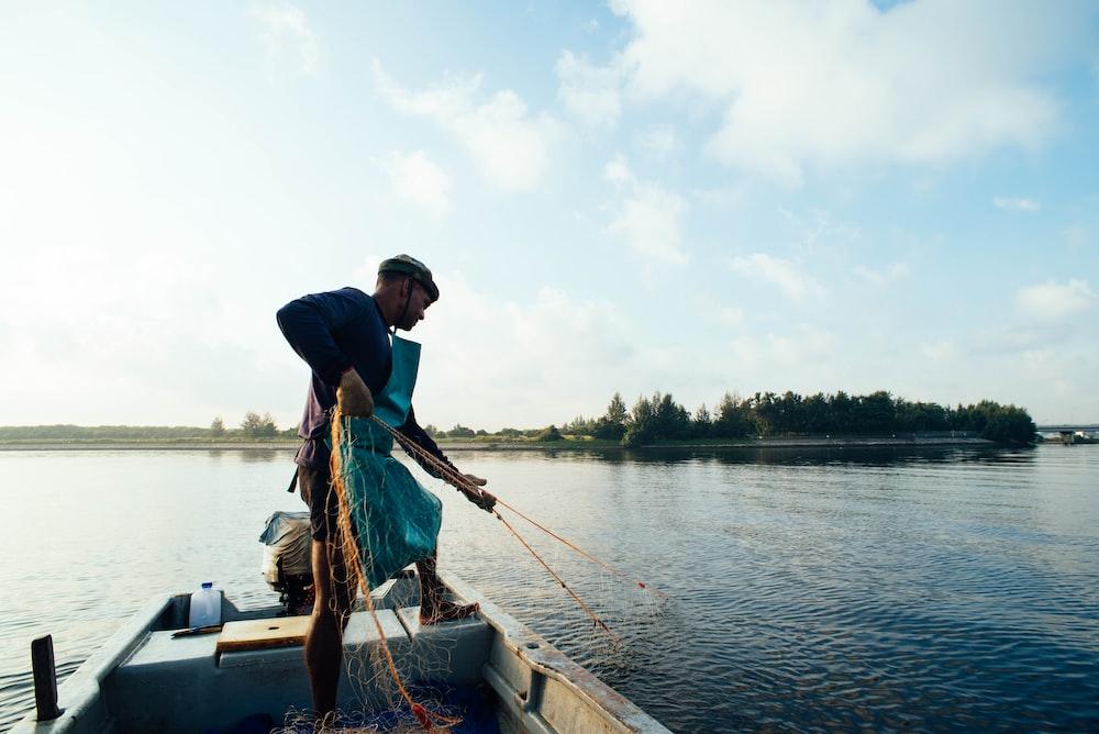 man doing fishing during daytime