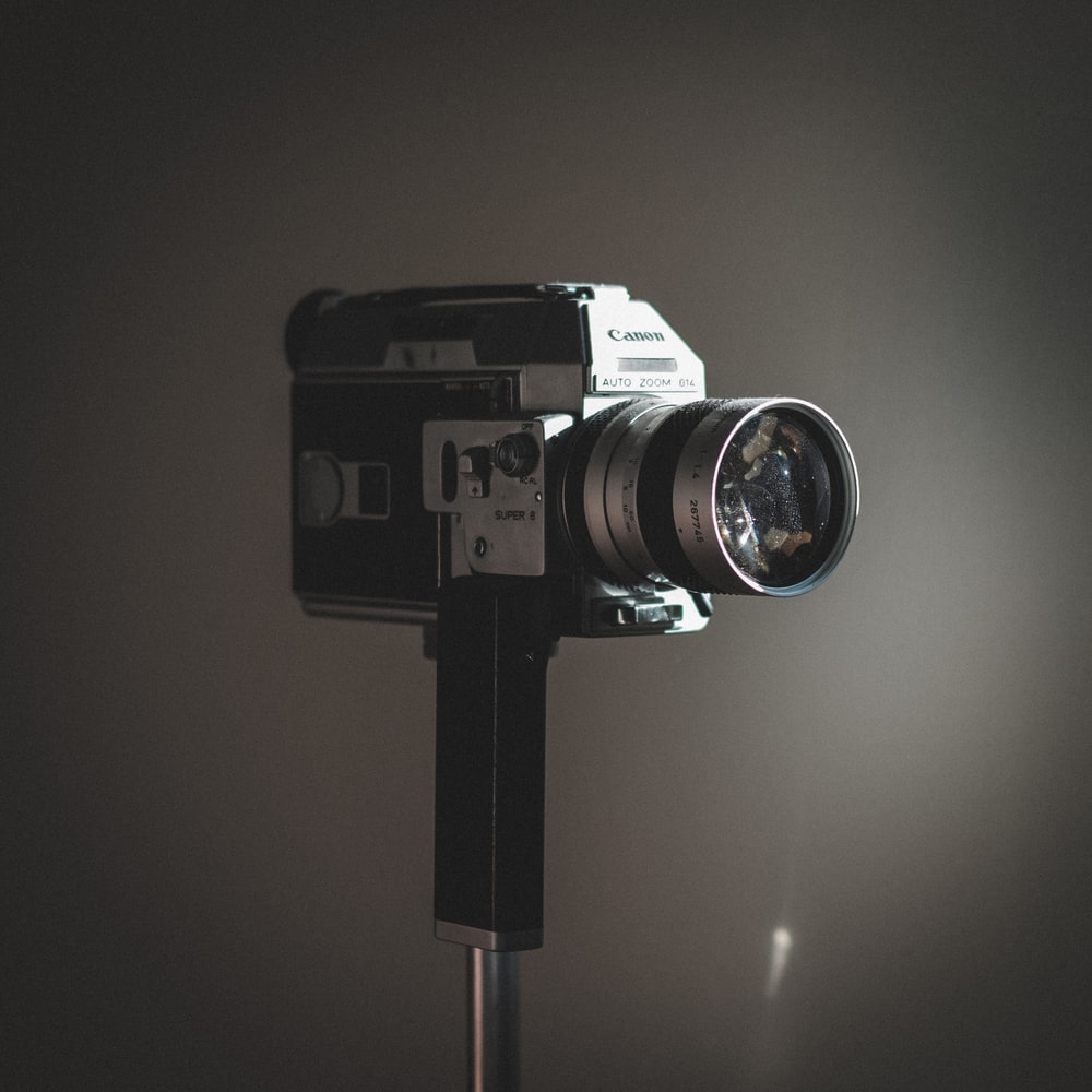 shallow focus photography of silver and black camera