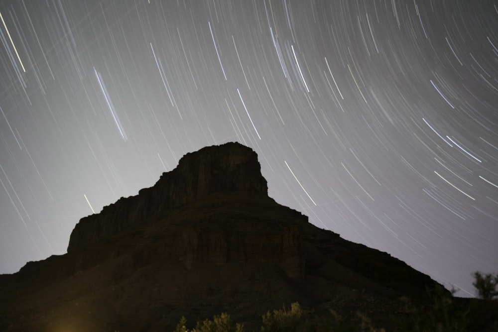 photo of mountain and star trail