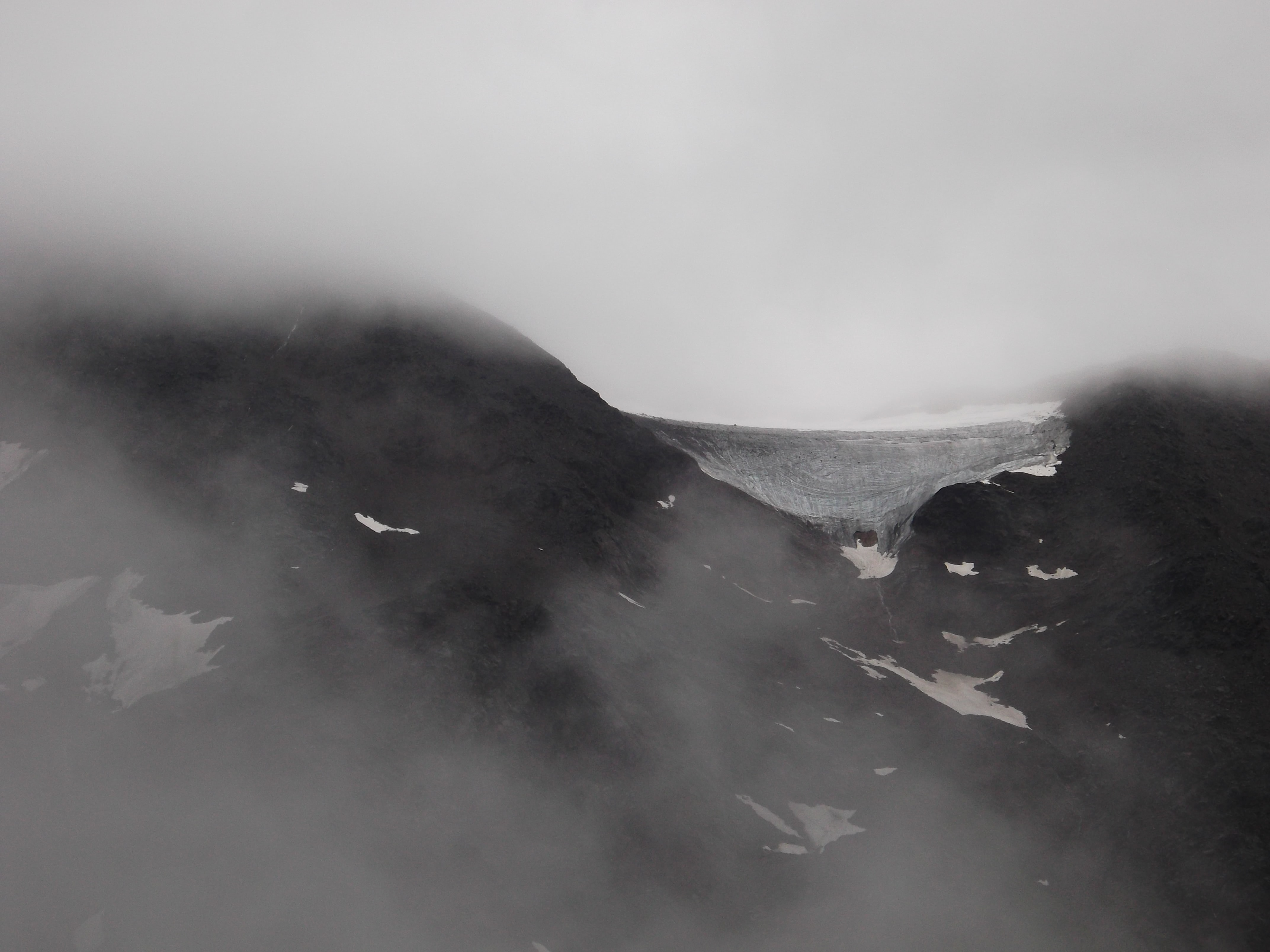 Gray misty mountains with snow during the winter