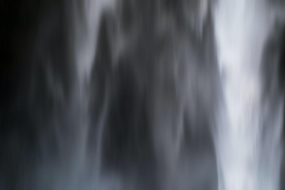 Black and white blurred close up shot of Seljalandsfoss waterfall