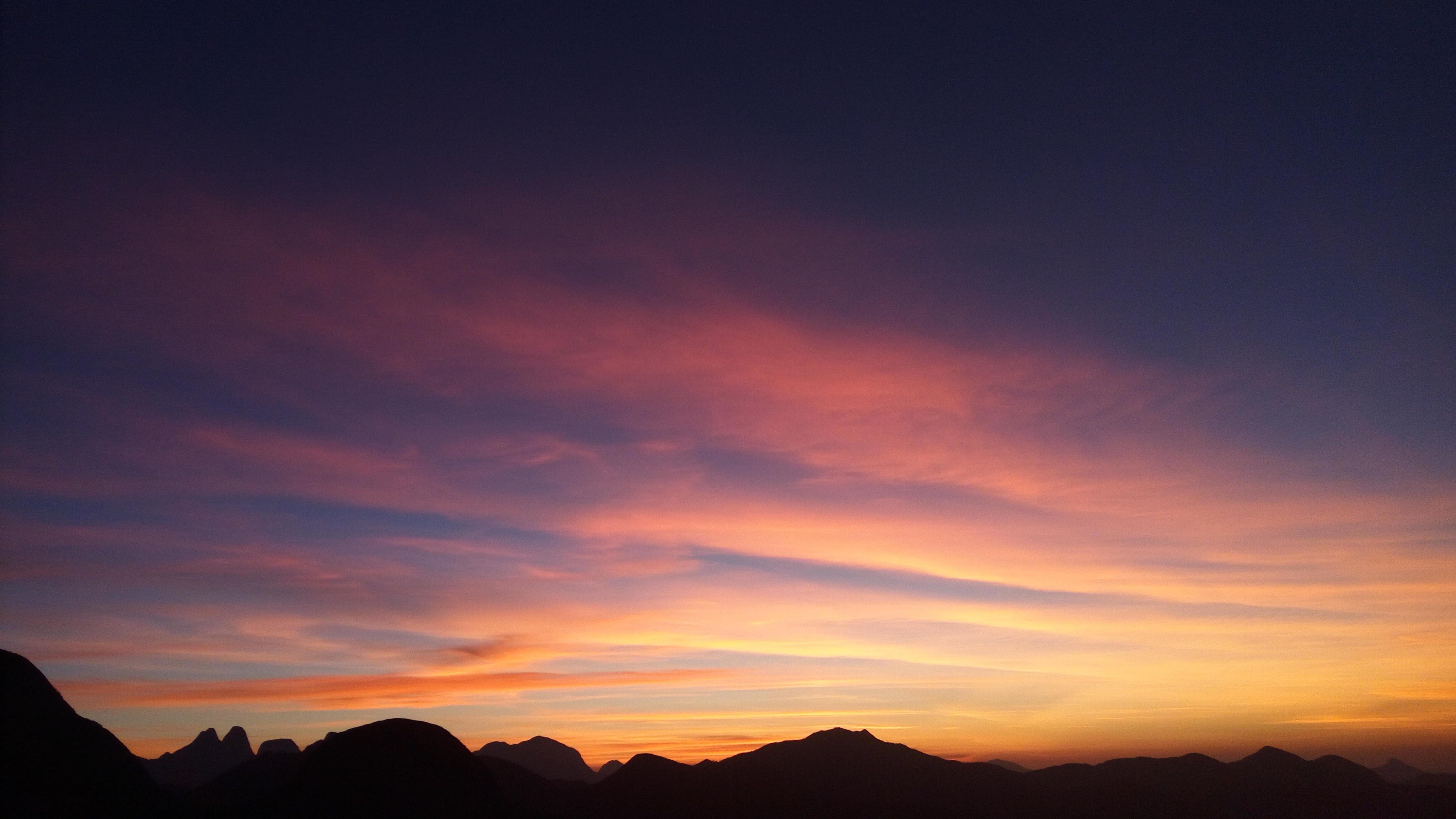 Silhouette of mountains in Rio de Janeiro in front of a sunset