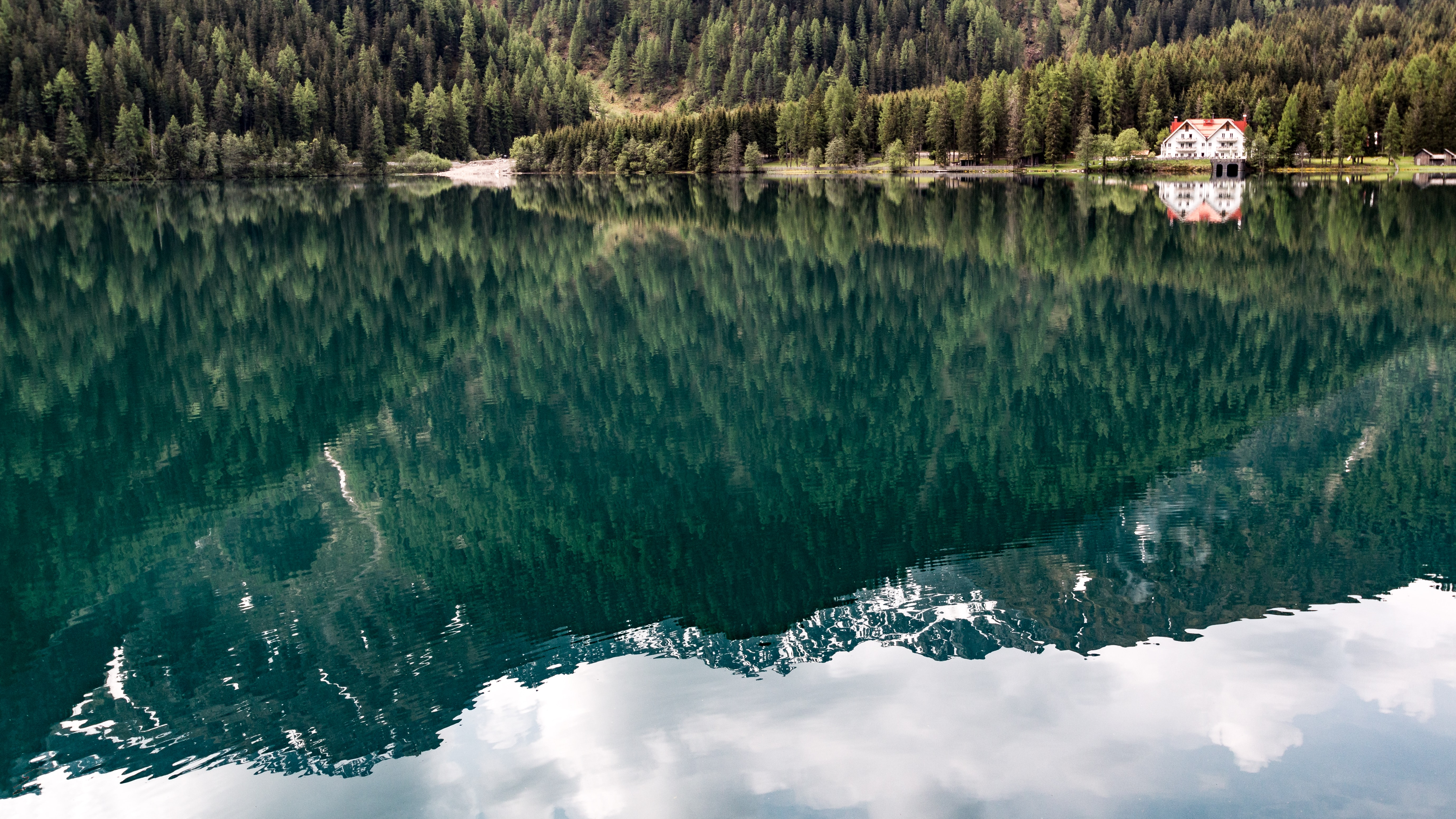 Mountains reflected in an emerald-green surface of a lake