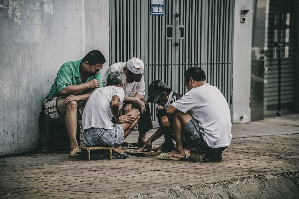 people playing beside street