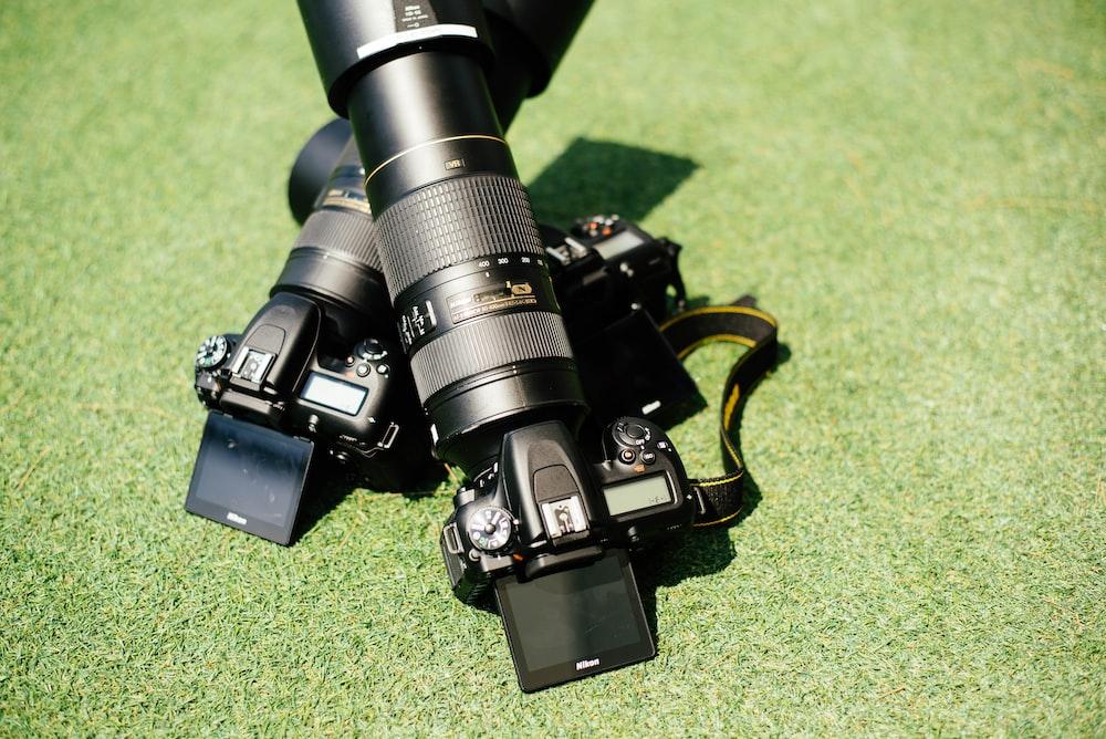black DSLR camera with zoom lens