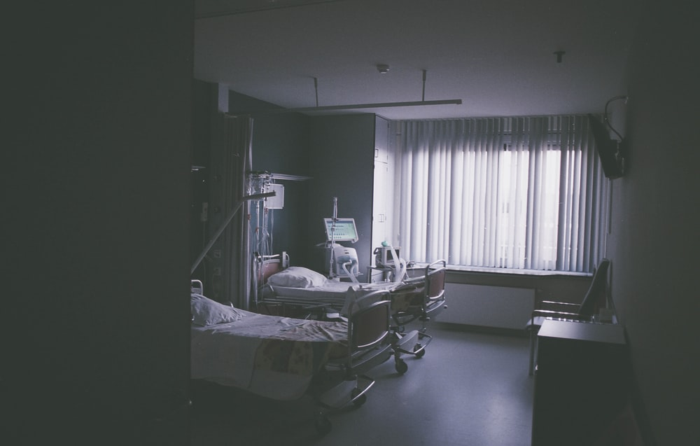 grayscale photography of nursing bed