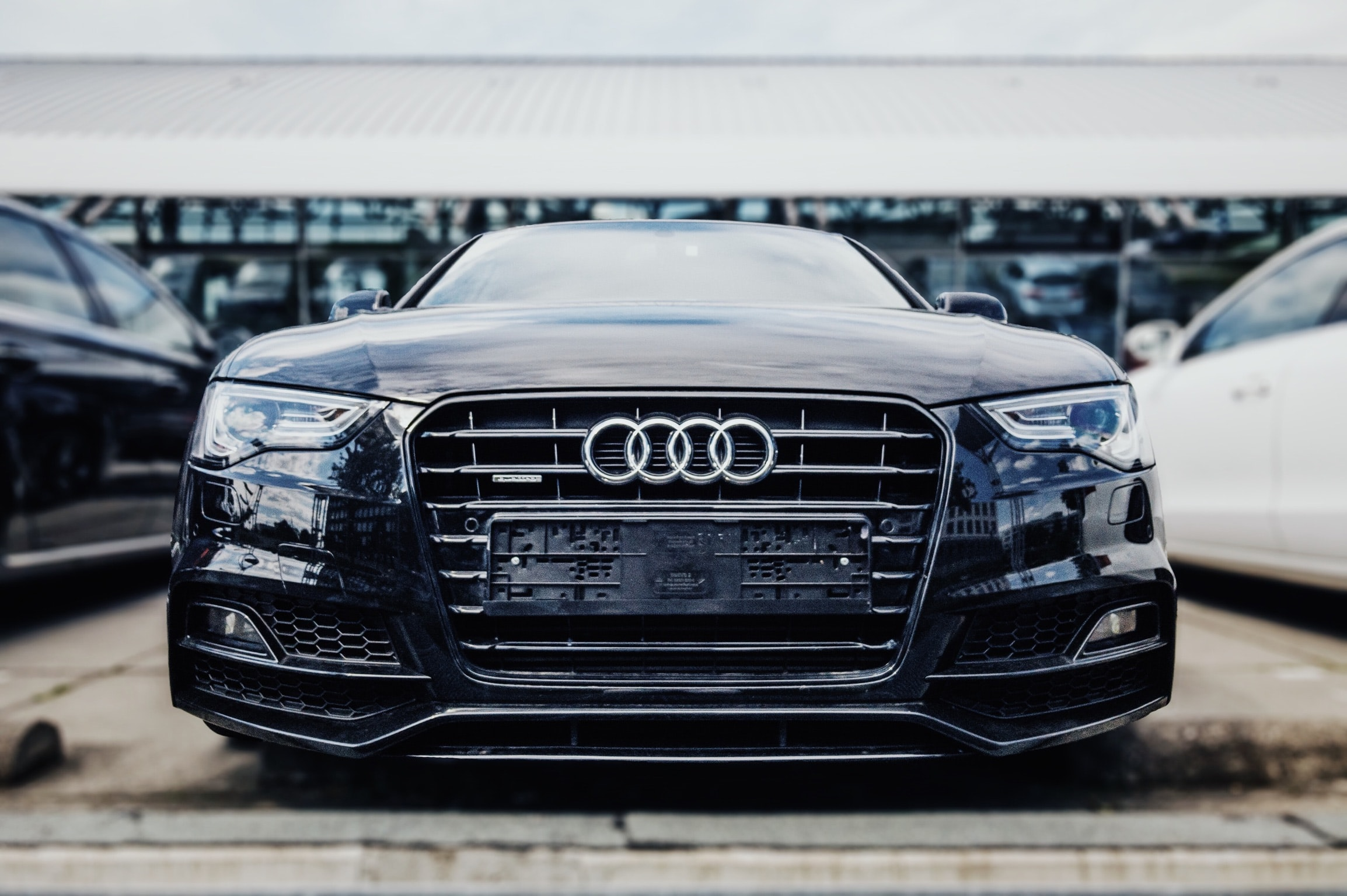 shallow focus photography of black Audi sedan