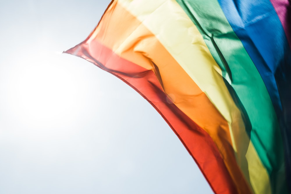 Rainbow pride flag flying in the daytime breeze