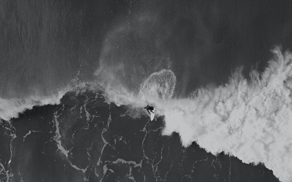 aerial photography of person surfing