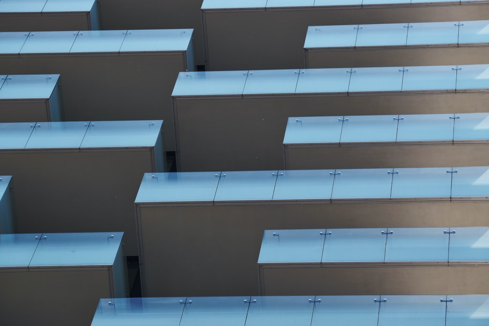 low-angle photography of gray high-rise building