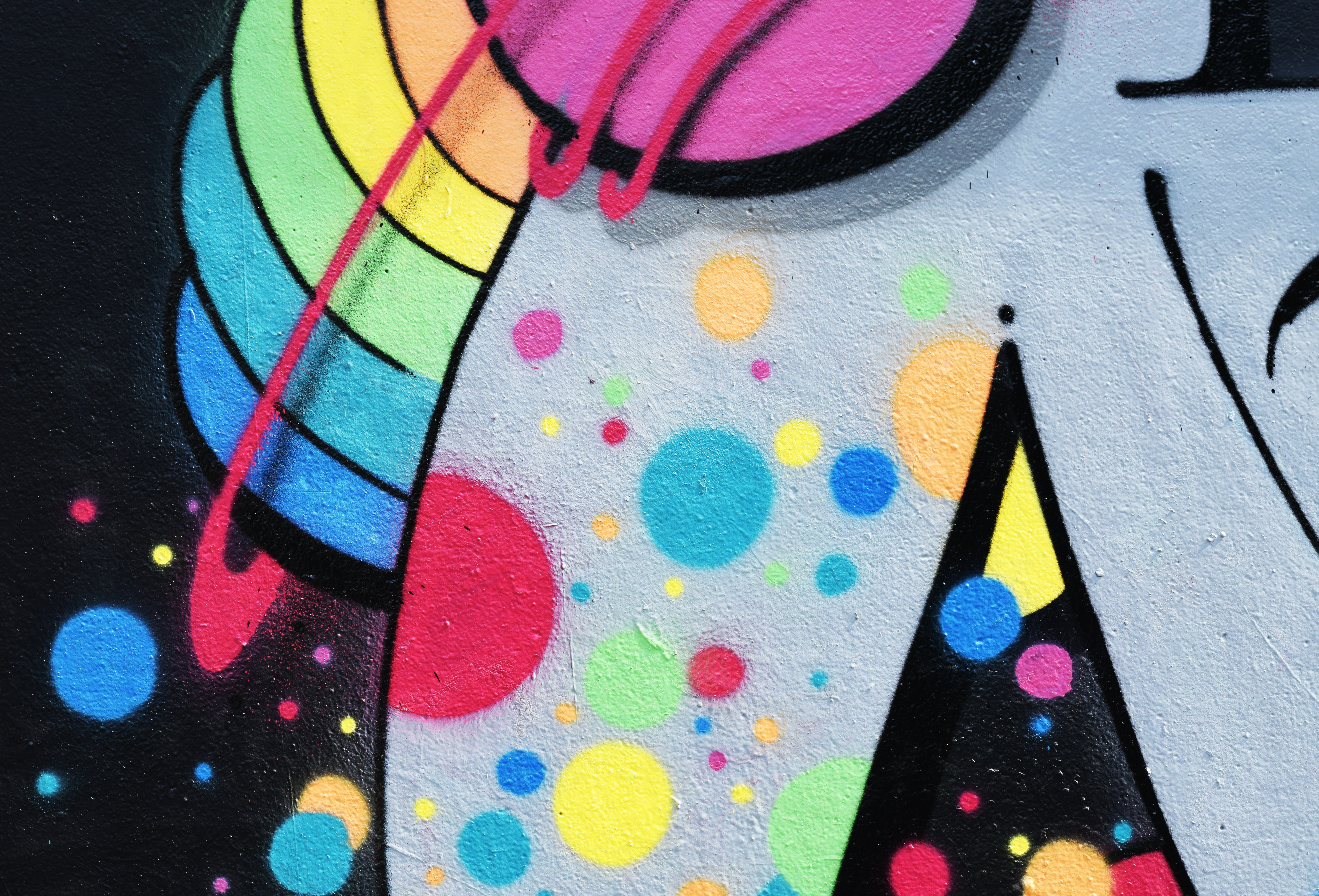 Brightly colored urban street art graffiti mural at Photo Week