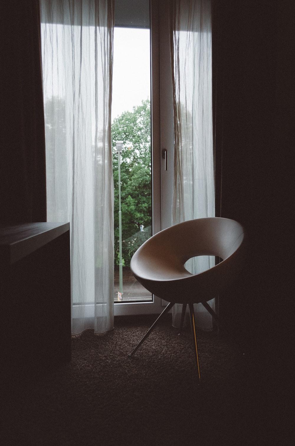 brown chair beside glass door