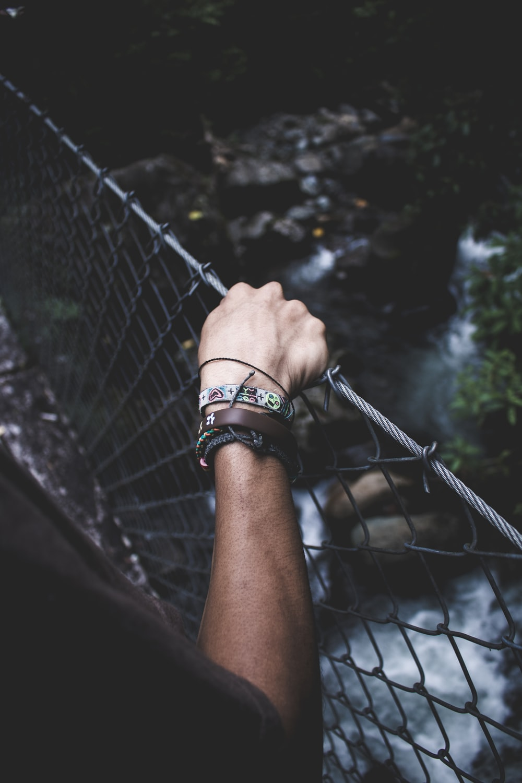 person crossing hanging bridge