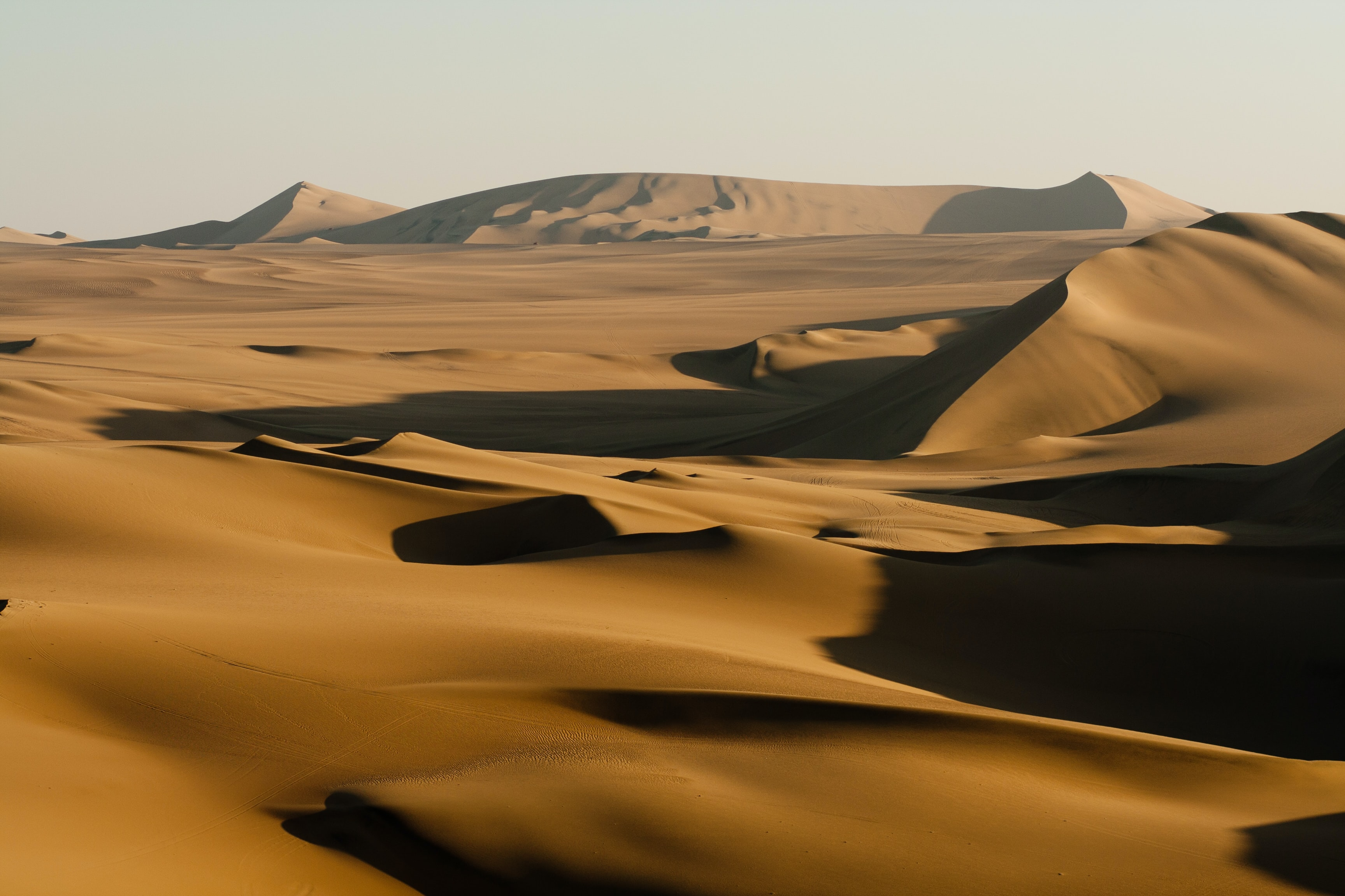 Shadows on rolling sand dunes in the desert of Huacachina