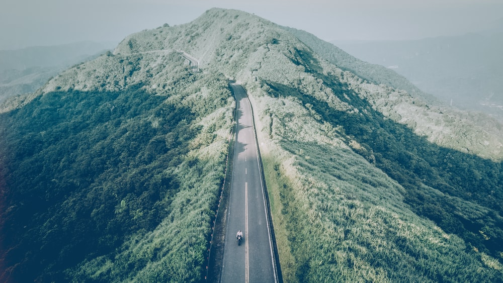 aerial photography of mountain with road
