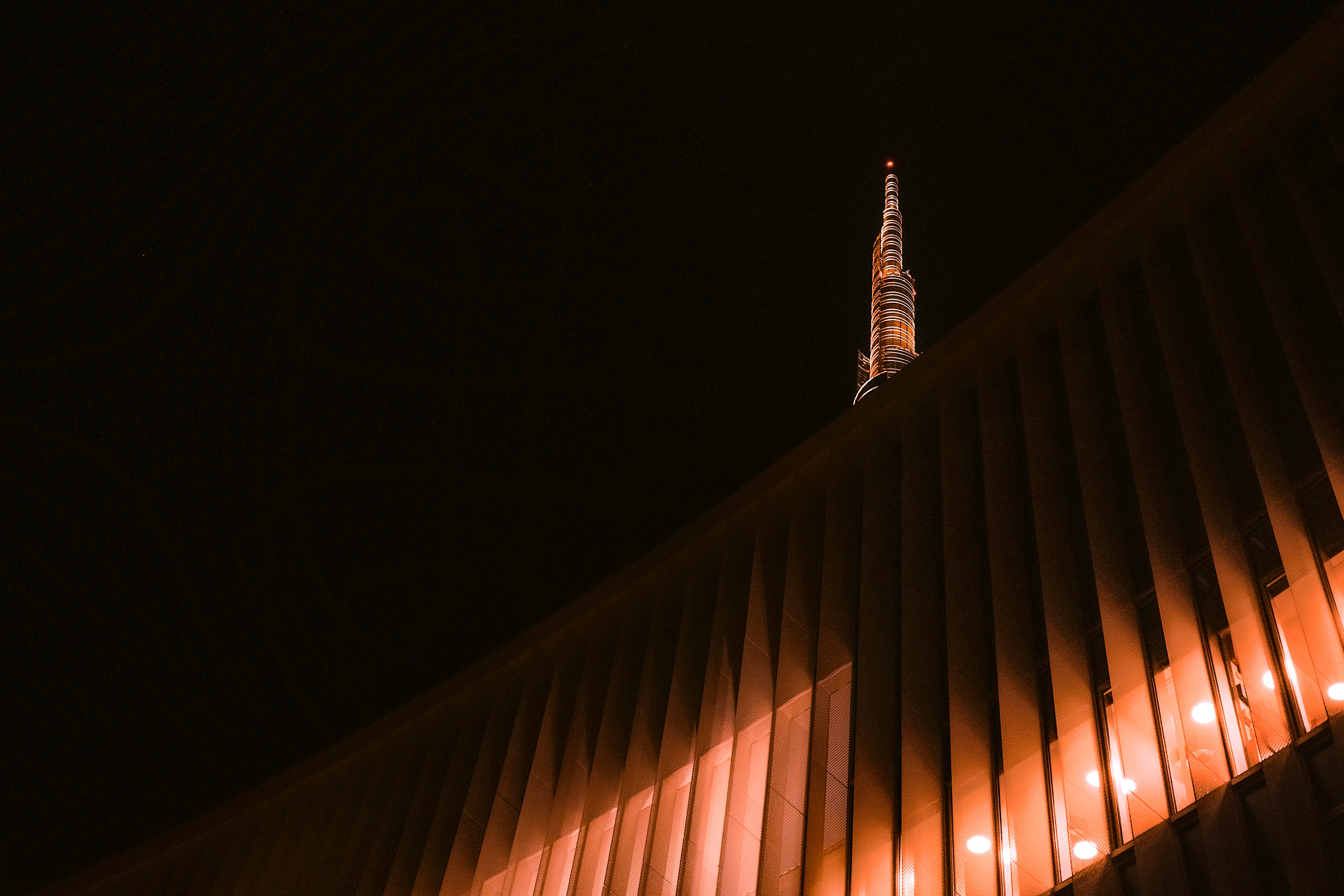 worm's-eye view of tower with orange lights