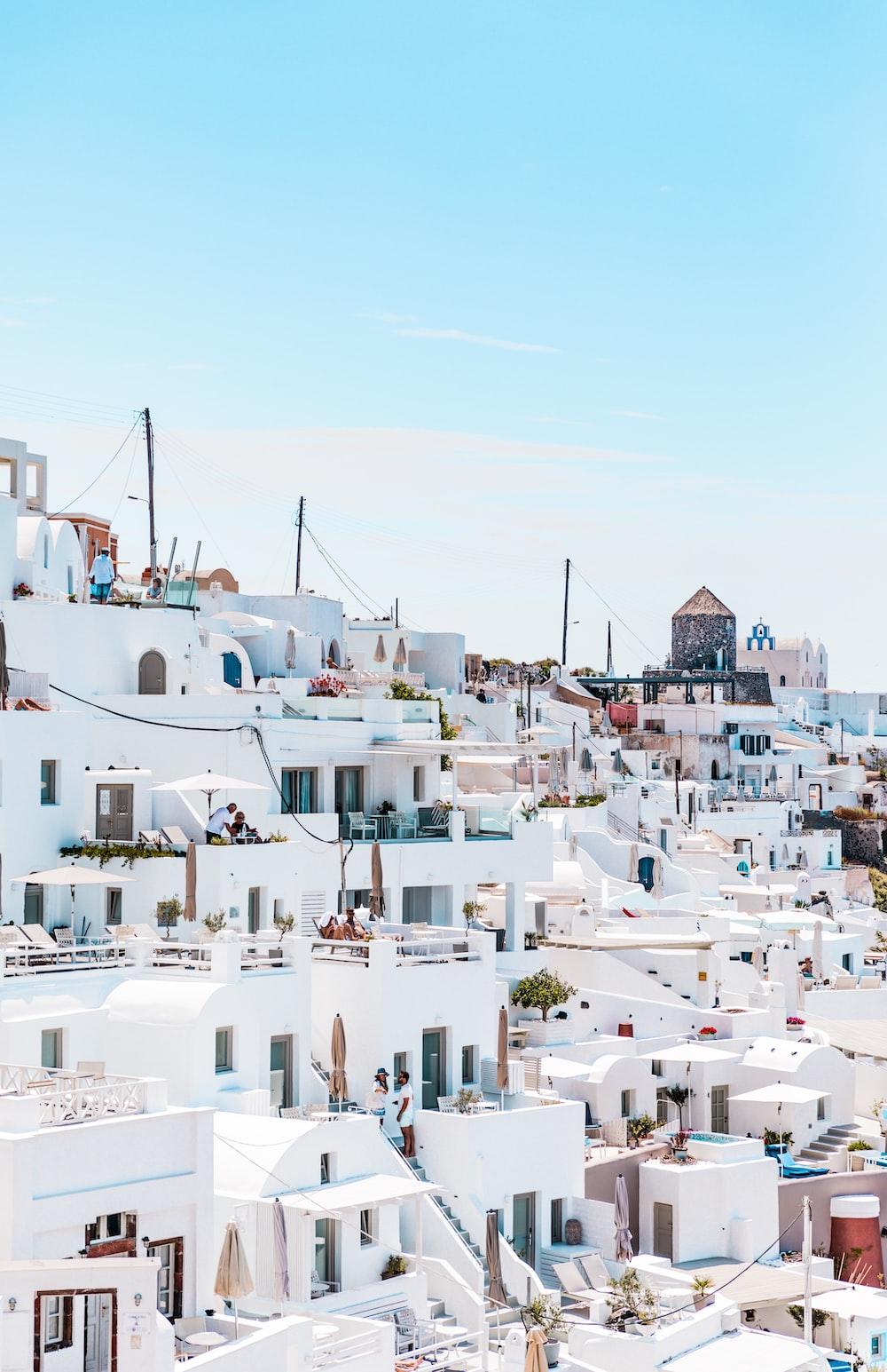 white concrete houses under blue sky at daytime