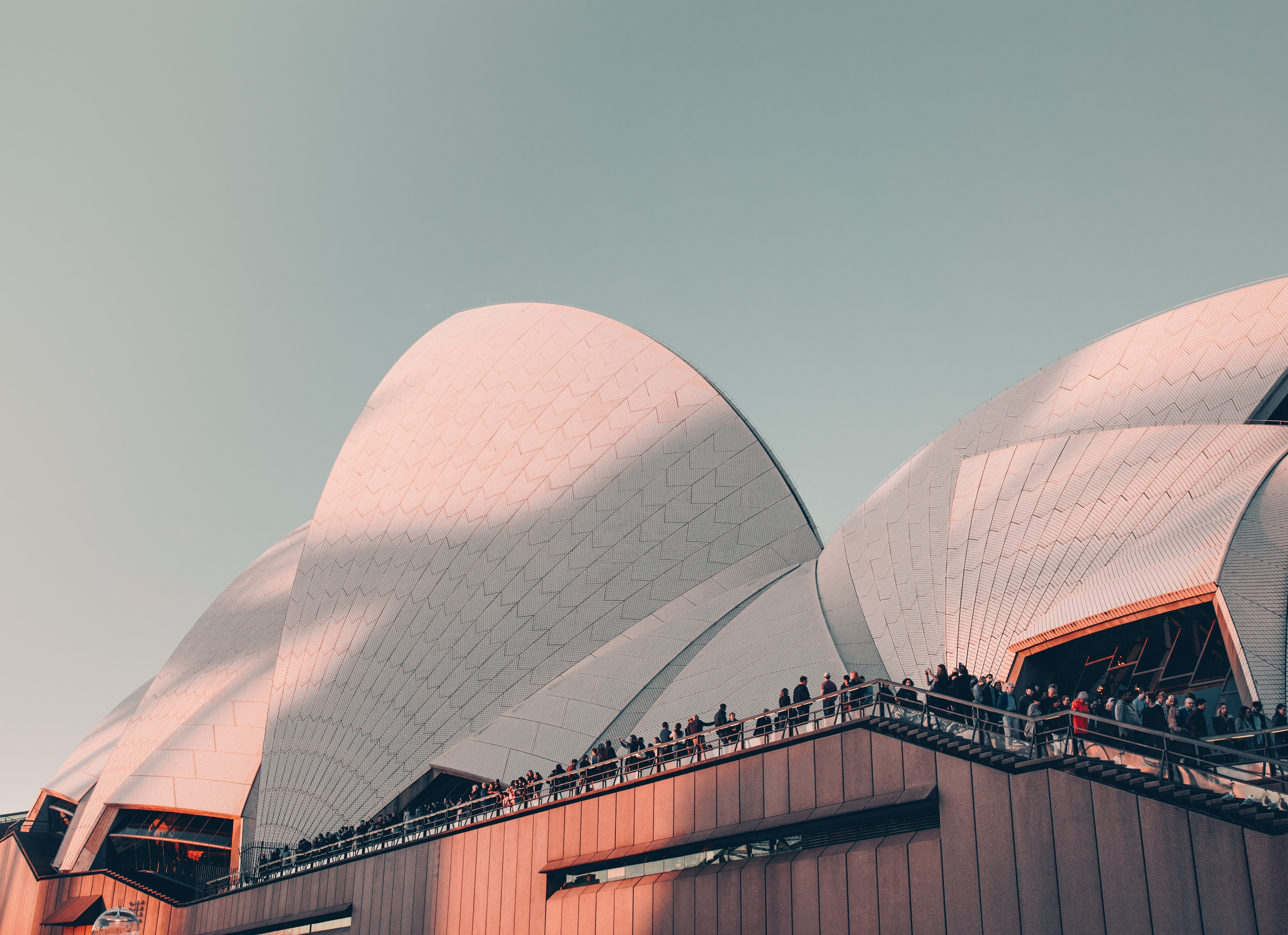 Sydney Opera house with people on the deck of the building