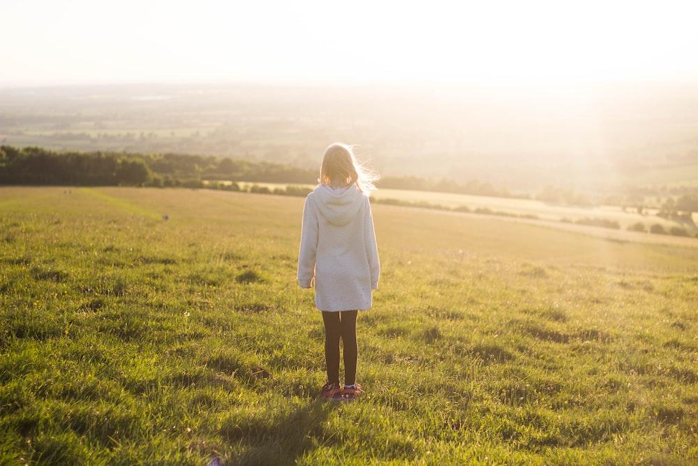 woman standing on green grass