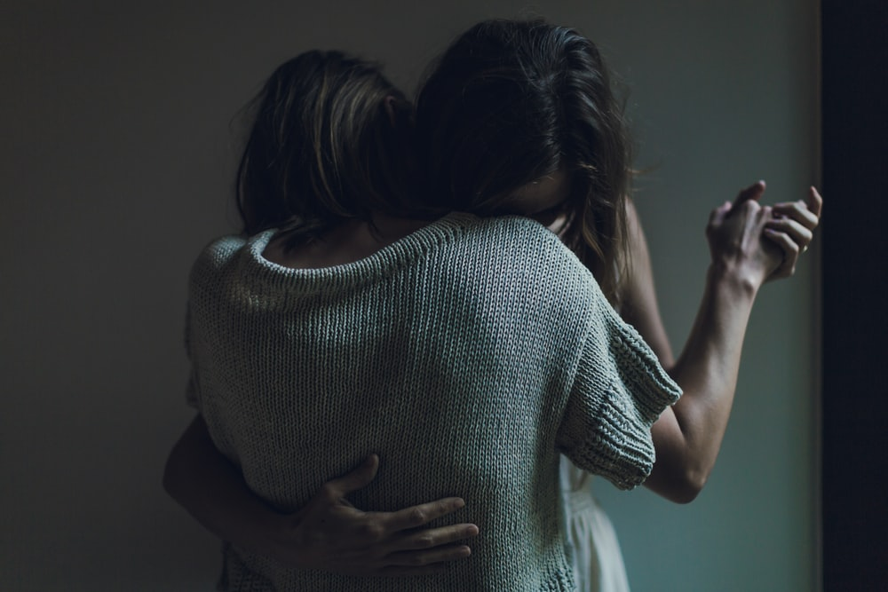 two women hugging each other
