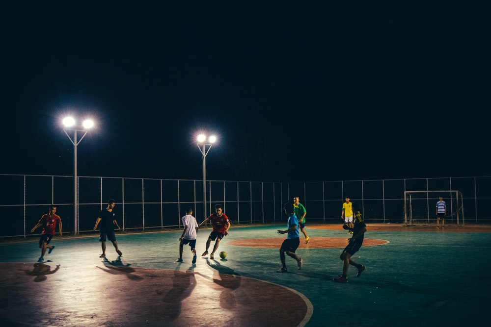 group of men playing football