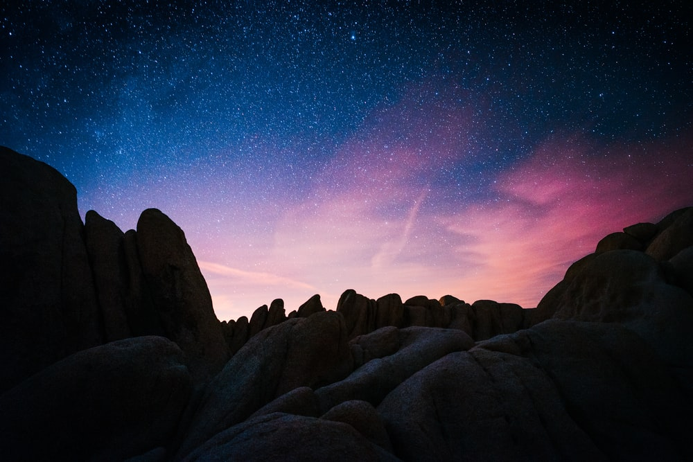 rock mountain during starry night