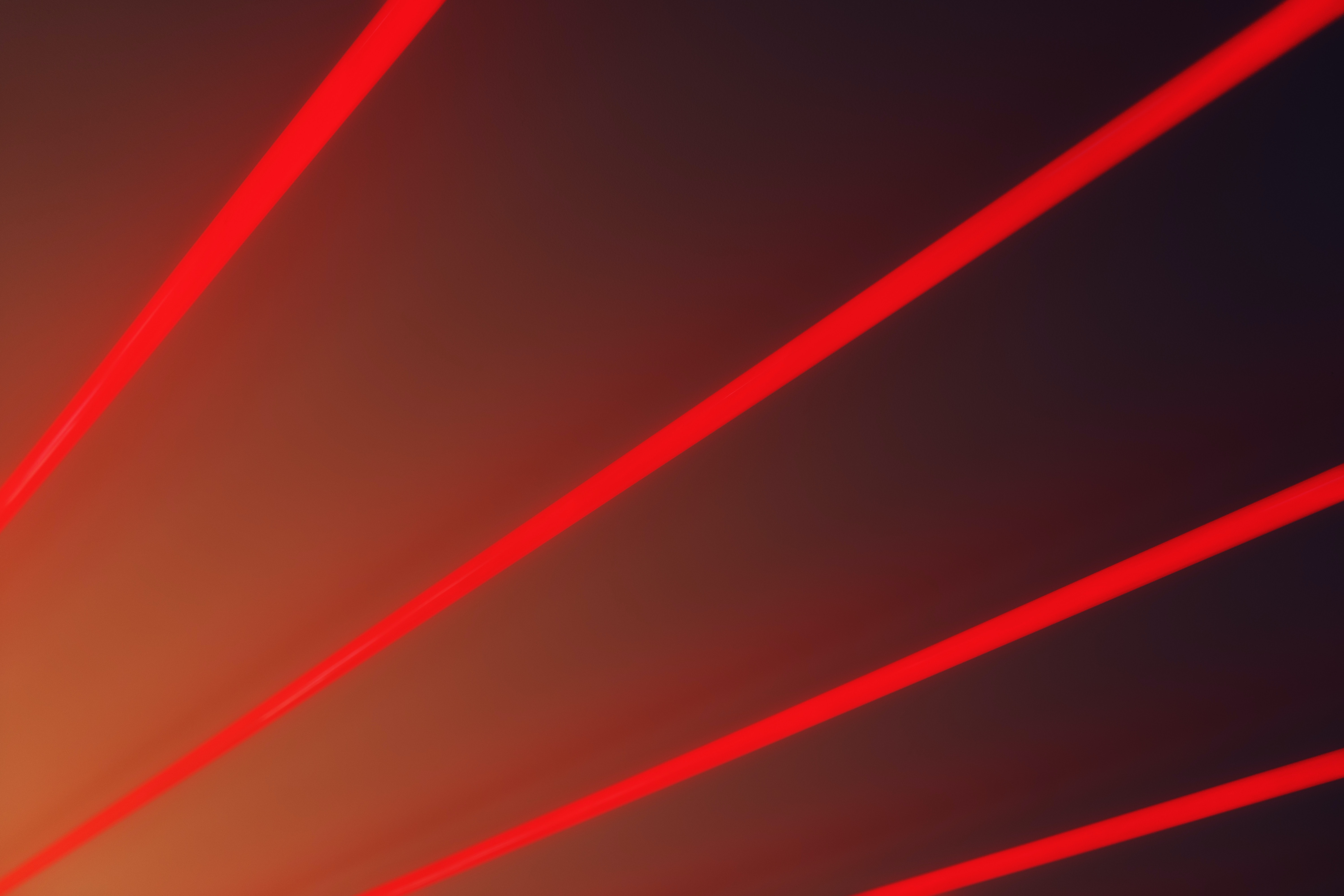 Red lasers shooting across.