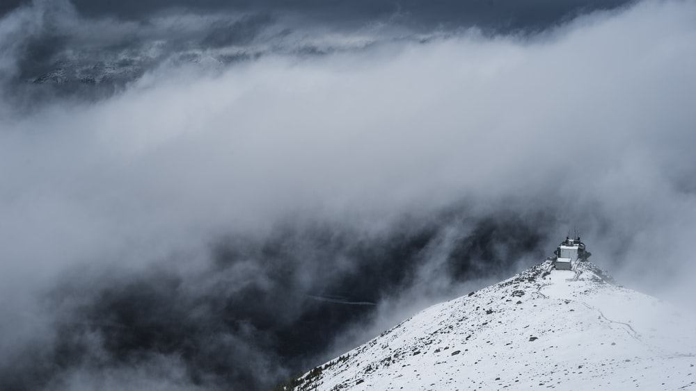 white mountain under white clouds at daytime