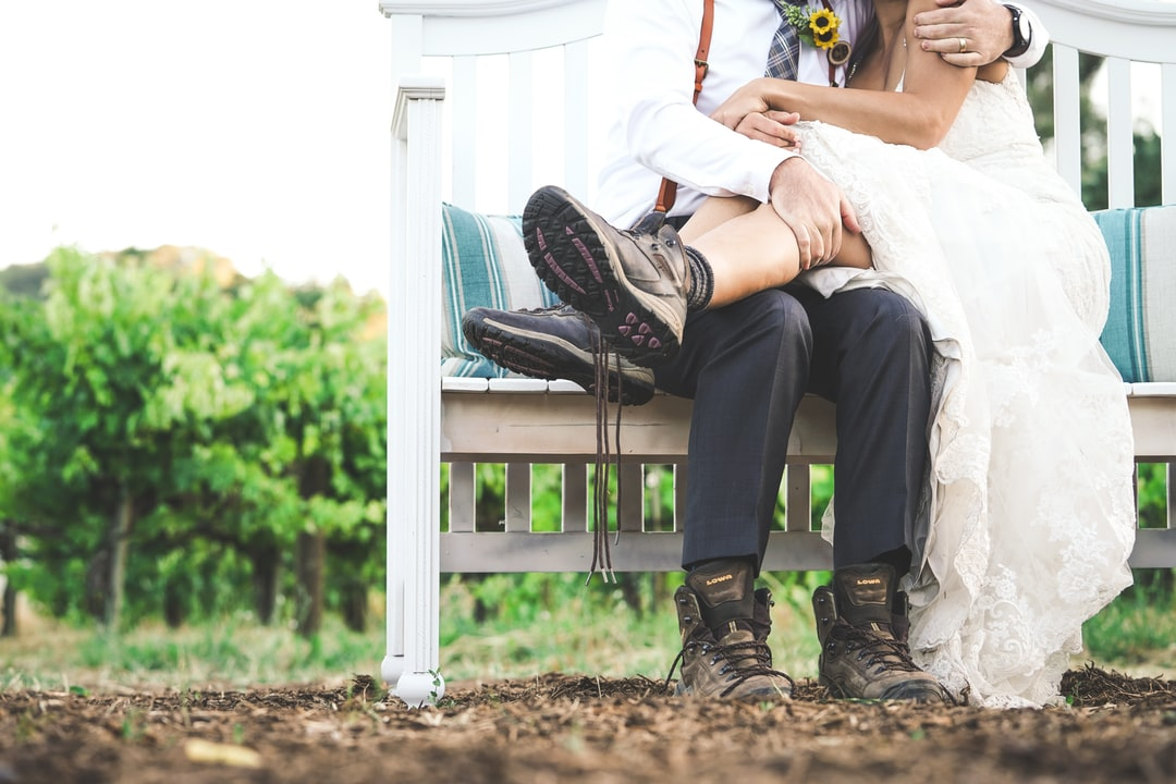 The perfect couple throws their hiking boots on during the wedding to show their true soles.