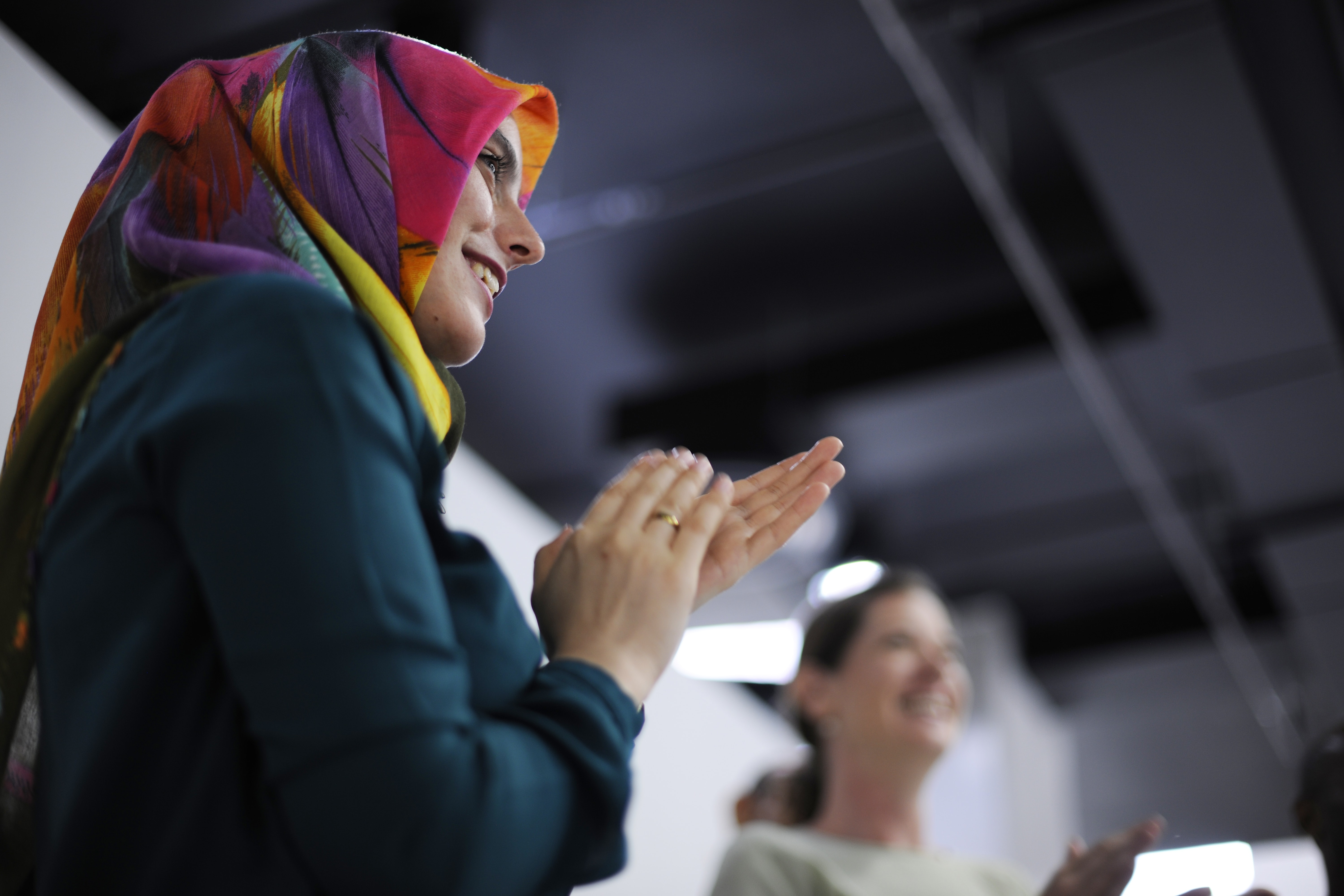 selective focus photography of woman clapping her hands inside room