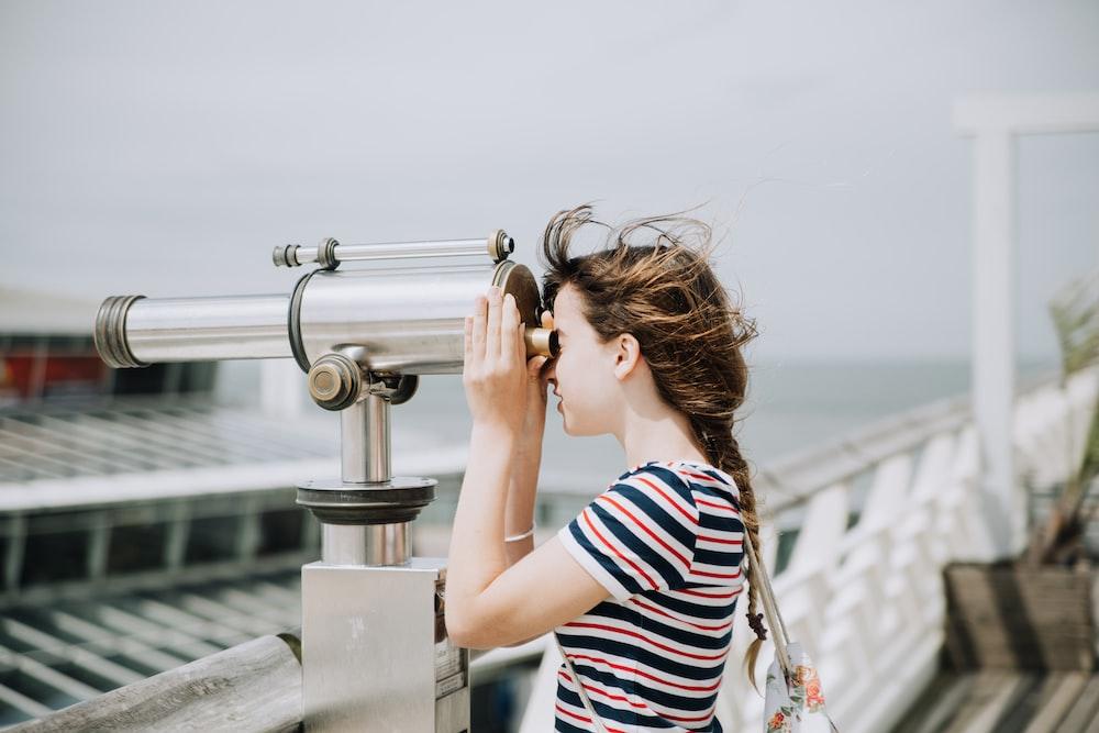 woman using telescope