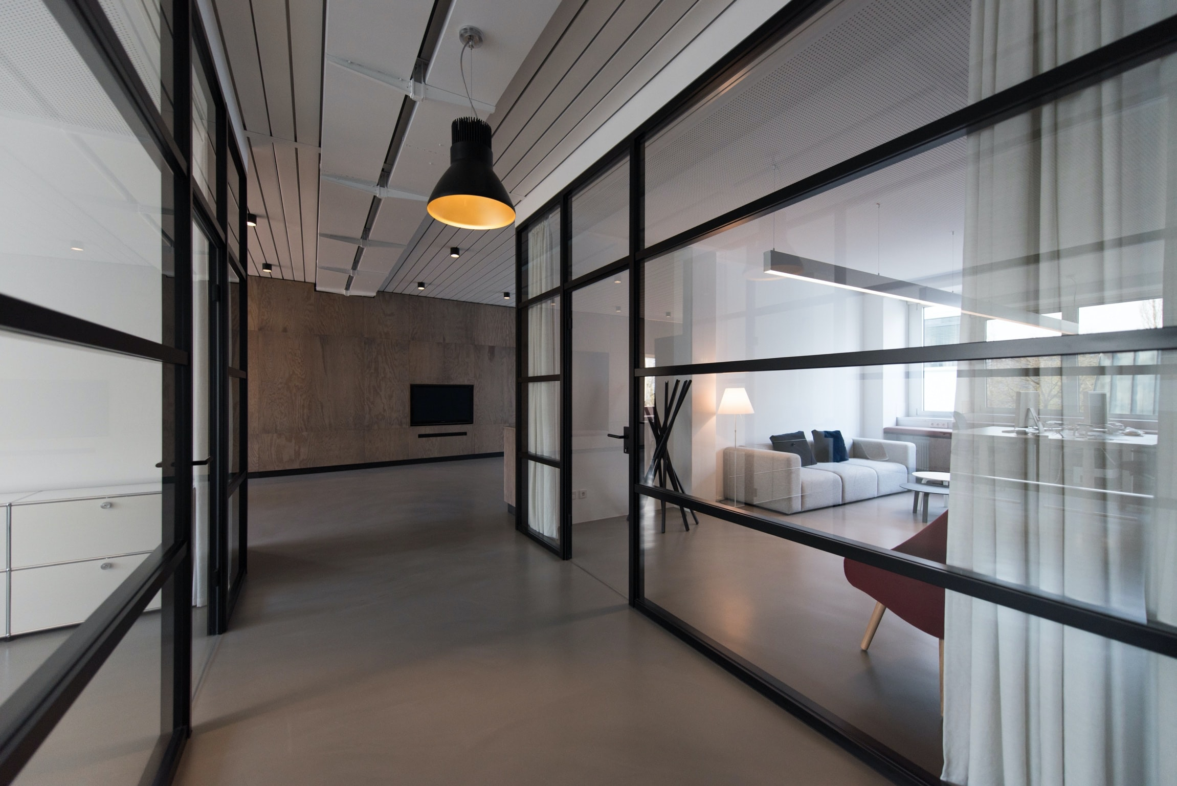 room with glass divider and white curtain