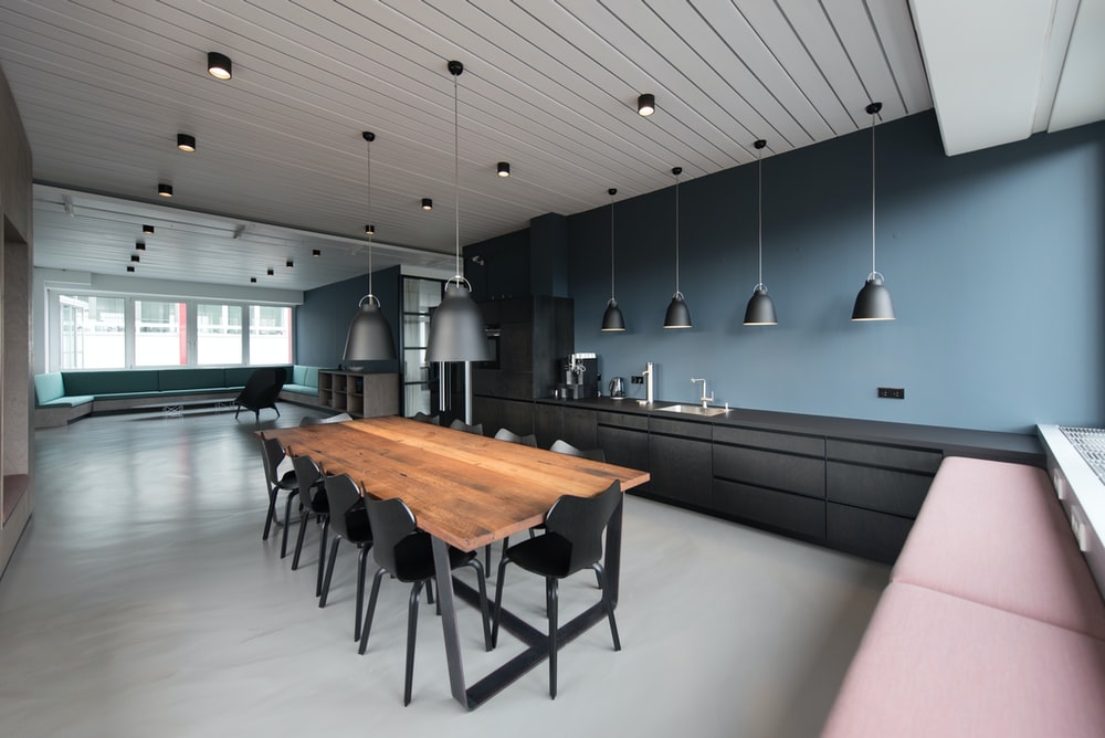 room with pendant lamps and rectangular dining set