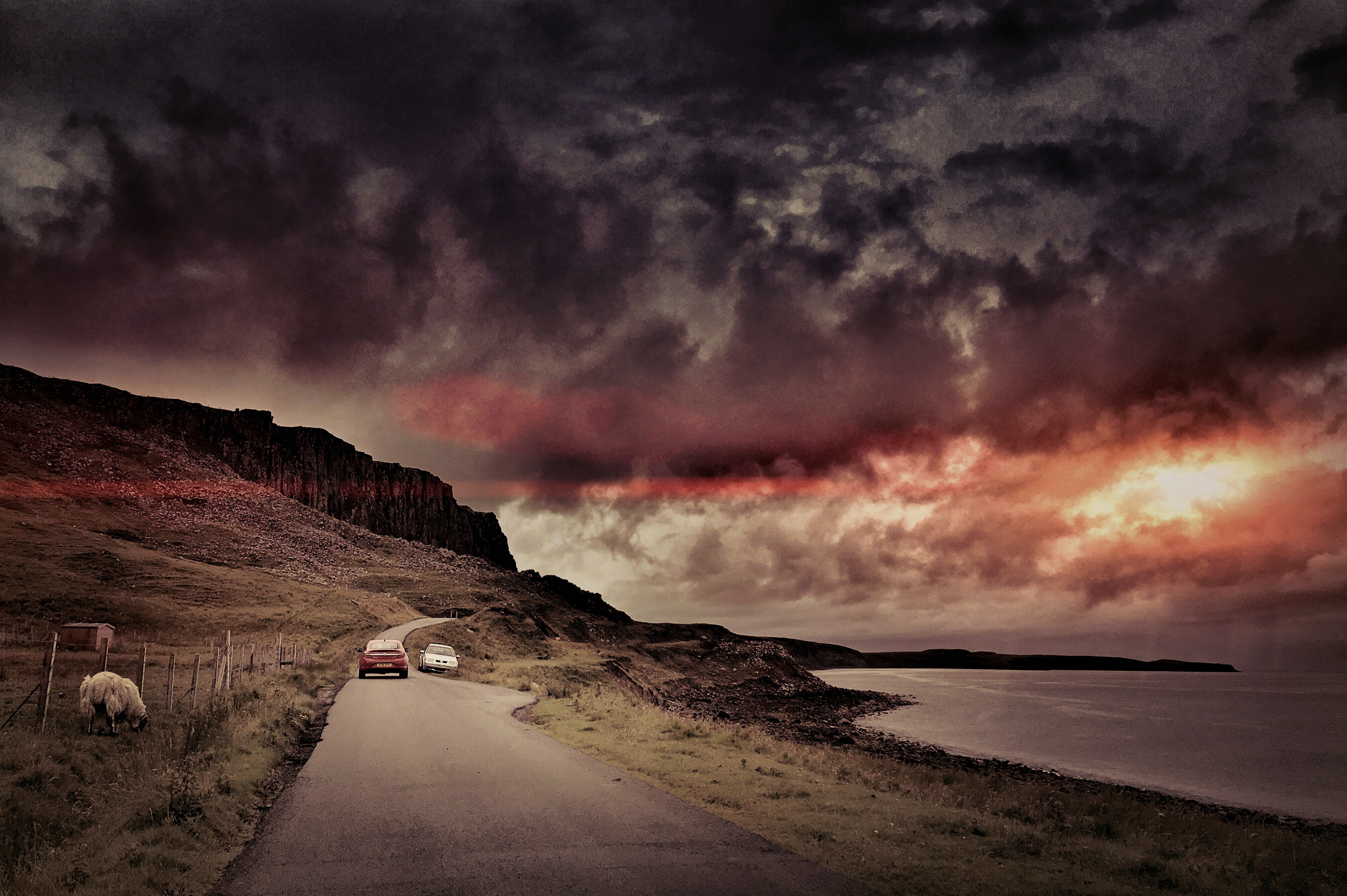 Coastal road at sunset dusk with moody sky in Kyle of Lockalsh