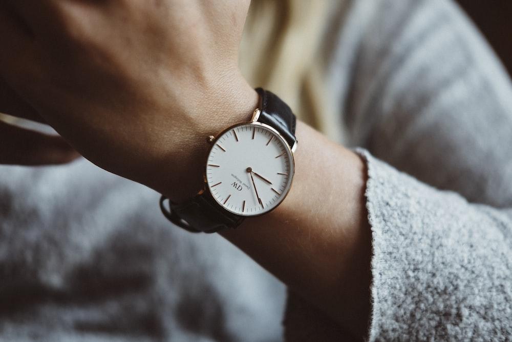 person wearing analog watch