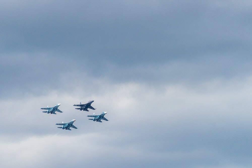 closeup photo of four fighting planes
