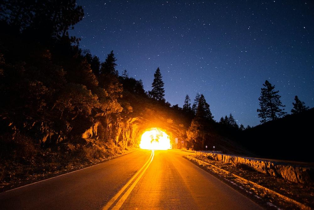 photo of concrete pavement heading tunnel