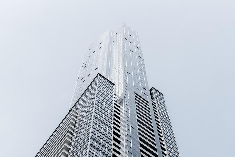 A tall skyscraper in Toronto against a pale blue sky