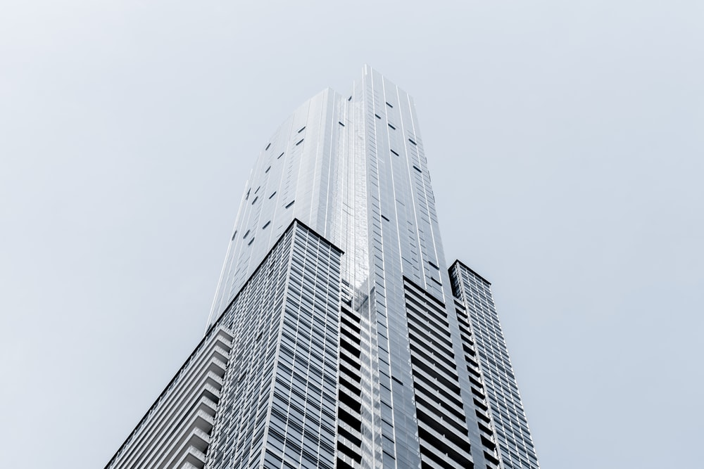 A tall skyscraper in Toronto against a pale blue sky