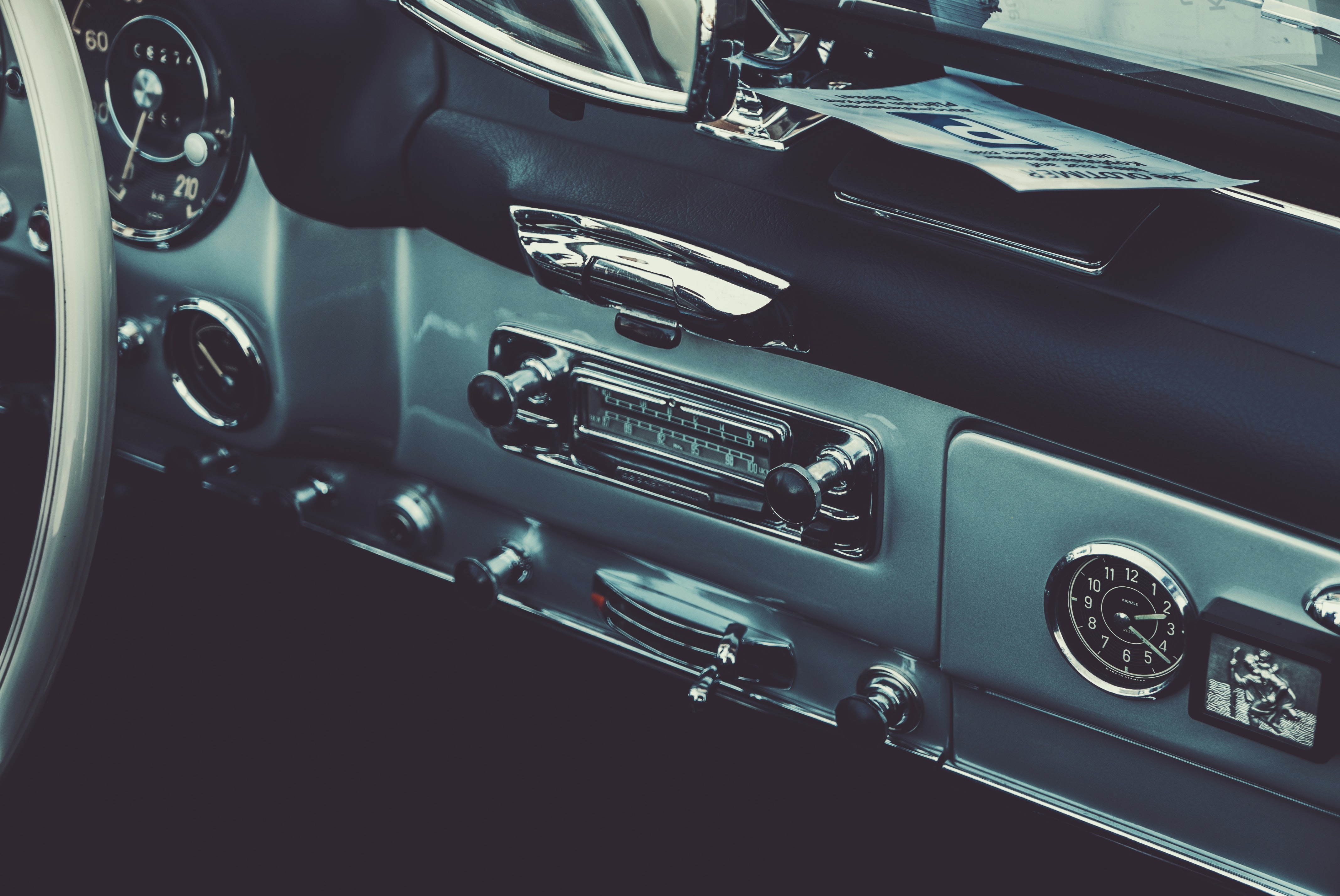 Cropped view of a vintage car's radio.