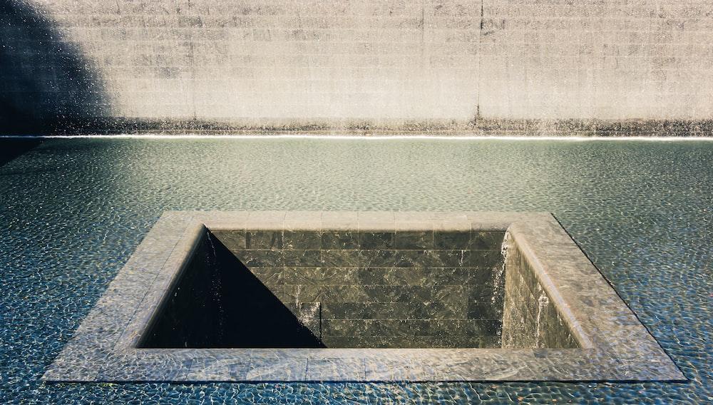 square brown concrete hole